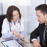 Female Doctor Showing Digital Tablet