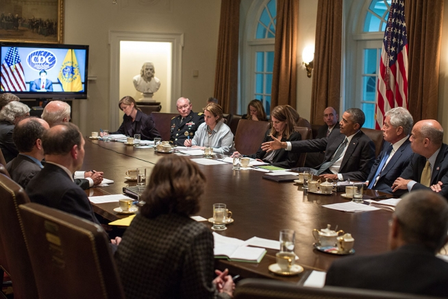 Photo: (Official White House Photo by Pete Souza) President Barack Obama convenes a meeting with cabinet agencies coordinating the government's Ebola response, in the Cabinet Room of the White House, Oct.15, 2014.