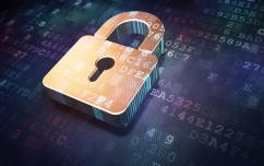Security concept: Golden closed padlock on digital background