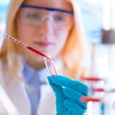 Girl with a pipette in a lab University Hospital
