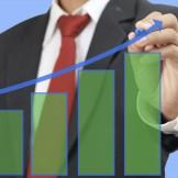 businessman drawing bar graph