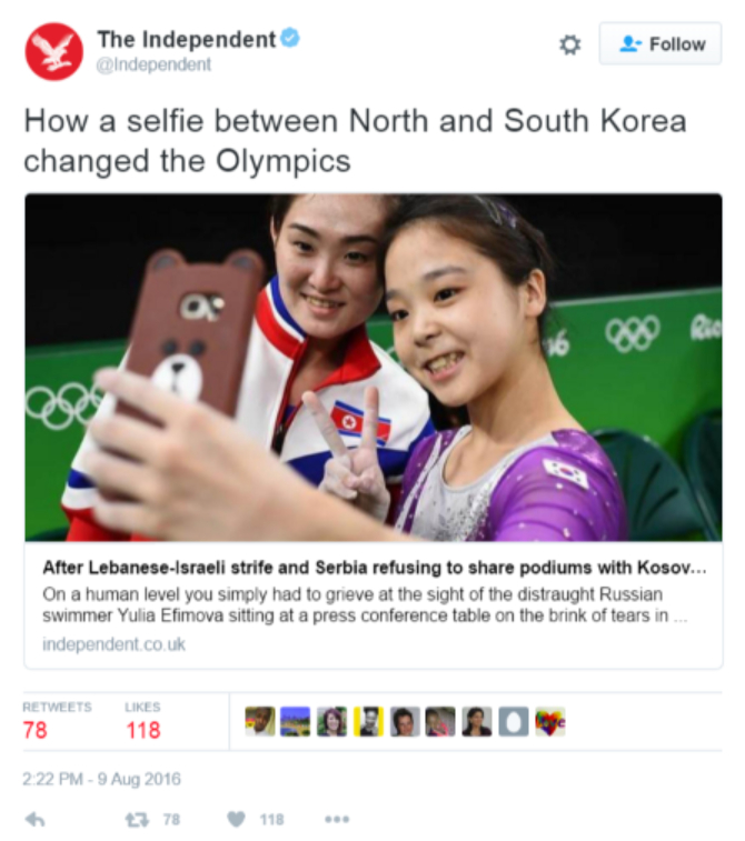 screenshot of tweet by The Independent showing North Korean and South Korean Olympic athletes selfie