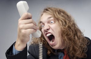 Crazy businessman screaming to the phone