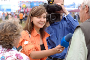 young woman journalist is interviewing on Baikal Day on August 3, 2008 at Baikal Lake, Buryatia, Russia