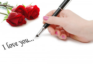 """""""I love you"""" message with roses and hand"""