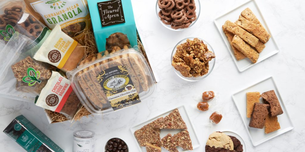 a photo of the various sweet and savory treats in a Packed With Purpose gift box
